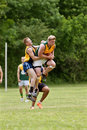 Player Jumps To Catch Ball In Australian Rules Football Game Royalty Free Stock Photo