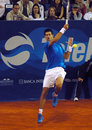 Player Novak Djokovic return a ball Stock Images