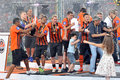 Players poured each other with champagne after the match between shakhtar donetsk city ukraine vs metarllurg donetsk city ukraine Royalty Free Stock Photography