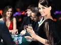 Players sitting around a table at a casino poker Royalty Free Stock Photography