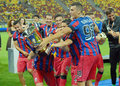 Players of steaua bucharest fighting for trophy the after the romanian supercup between bucharesta and petrolul ploiesti Stock Photo