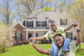 Playful african american father and son in front of home yard Royalty Free Stock Image