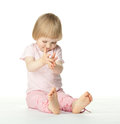 Playful baby girl clapping her hands Royalty Free Stock Photo