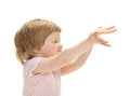 Playful baby reaching hands out Stock Photography