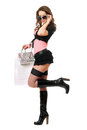 Playful beautiful young woman after shopping. Isolated