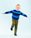 Playful boy little on studio light blue background Royalty Free Stock Image