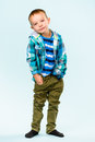 Playful boy little on studio light blue background Stock Photos