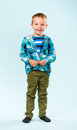 Playful boy little on studio light blue background Royalty Free Stock Photo