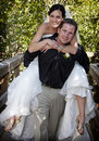 Playful Bride and Groom piggyback Royalty Free Stock Photo