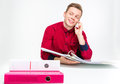 Playful cheerful young man using binders and talking on cellphone attractive in red shirt over white background Stock Photos