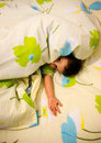 Playful child in bed Royalty Free Stock Photos