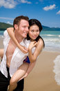 Playful couple at the beach lo Stock Photography