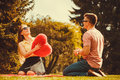 Playful couple in park. Royalty Free Stock Photo
