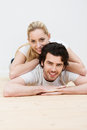 Playful couple relaxing together on the floor attractive young Royalty Free Stock Photography