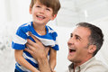 Playful father and son portrait of happy playing raises his in the air Royalty Free Stock Image