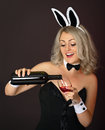 Playful girl at the party pours wine Stock Photo