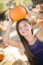 Playful Girl Portrait at the Pumpkin Patch Royalty Free Stock Photo