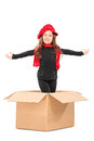 Playful girl standing in a box isolated on white background Royalty Free Stock Image
