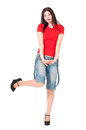 Playful girl young woman dressed in shorts and a t shirt isolated on white background Royalty Free Stock Images