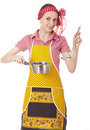Playful housewife with ladle and pan Royalty Free Stock Image