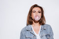 Playful lady blowing bubble with chewing gum. Royalty Free Stock Photo