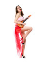 Playful lady with toy guitar in short red skirt isolated on white Royalty Free Stock Photos