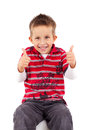 Playful little boy thumbs up Stock Images
