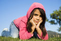 Playful little girl mixed race smiling lying on the meadow Stock Images