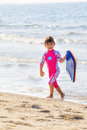 Playful little girl at the seaside. Royalty Free Stock Photo