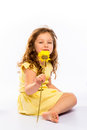 Playful little girl in yellow dress smiling on white background Royalty Free Stock Photos