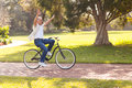 Playful man bike middle aged riding a outdoors with arms up Stock Photo