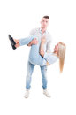 Playful man dropping girl for fun men happy couple concept on white background Royalty Free Stock Photography