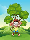 A playful monkey at the hilltop near the tree illustration of Royalty Free Stock Photo