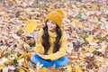 Playful mood. Warm woolen accessory. Girl long hair happy face fall nature background. Keep you warmest this autumn Royalty Free Stock Photo
