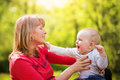 Playful mother having fun with her baby in nature Royalty Free Stock Photo