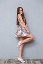 Playful pretty young woman posing on one leg Royalty Free Stock Photo