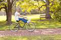 Playful senior bicycle man riding at the park Royalty Free Stock Photo