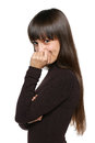 Playful shy woman hiding face smiling timid over white background Stock Photos