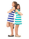 Playful sisters standing back to back isolated on white background Royalty Free Stock Photography