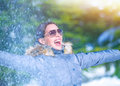 Playful woman on winter park having fun throwing snow enjoying wintertime nature active lifestyle happiness concept Stock Photography