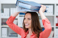 Playful young business clerk with folders female balanced on her head smiling happily Stock Photography