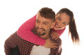 Playful young couple with woman riding piggyback fashionable women jumping to the men back and Stock Photo