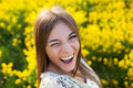 Playful young woman among yellow flowers in a field Royalty Free Stock Images