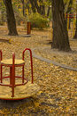 Playground autumn park in the childrens strewn with leaves Stock Images