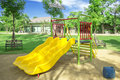 Playground a children s a slider located on the sand Stock Photo