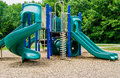 Playground fun nice neighborhood with swings slides and climbing Royalty Free Stock Photo
