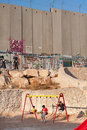 Playground and Israeli Separation Wall Royalty Free Stock Photo