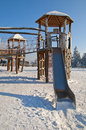 Playground for kids at winter with snow and ice Stock Image