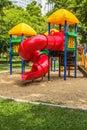 Playground in park for children red spiral slider Royalty Free Stock Photos