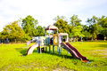 Playground park on grass near school is children this Royalty Free Stock Photography